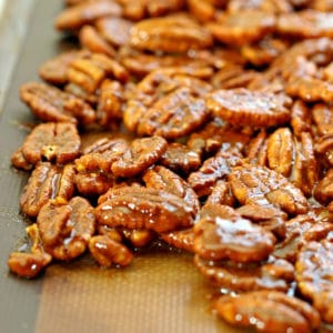 A pile of spiced pecans on baking sheet