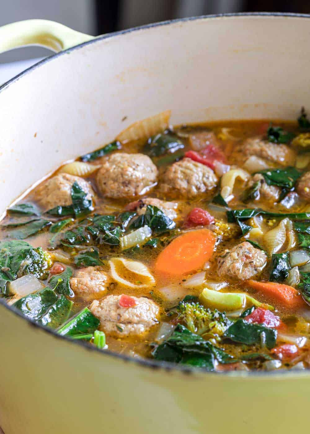 A pot of Meatball and vegetable Soup