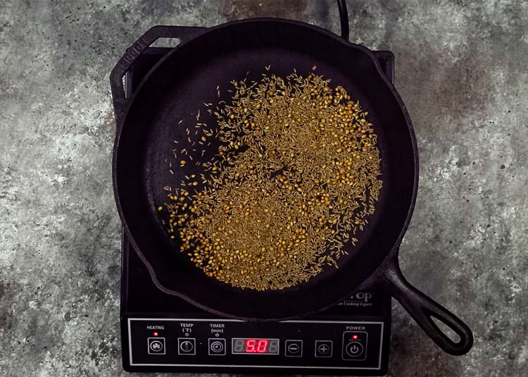 toasting spices in cast iron pan