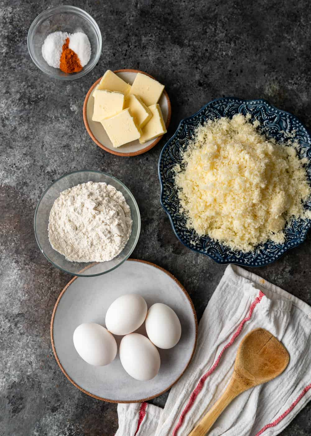 eggs, butter, flour and other ingredients to make choux pastry recipe for cheesy appetizers called gougeres