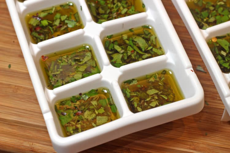 herbs in cube tray with oil