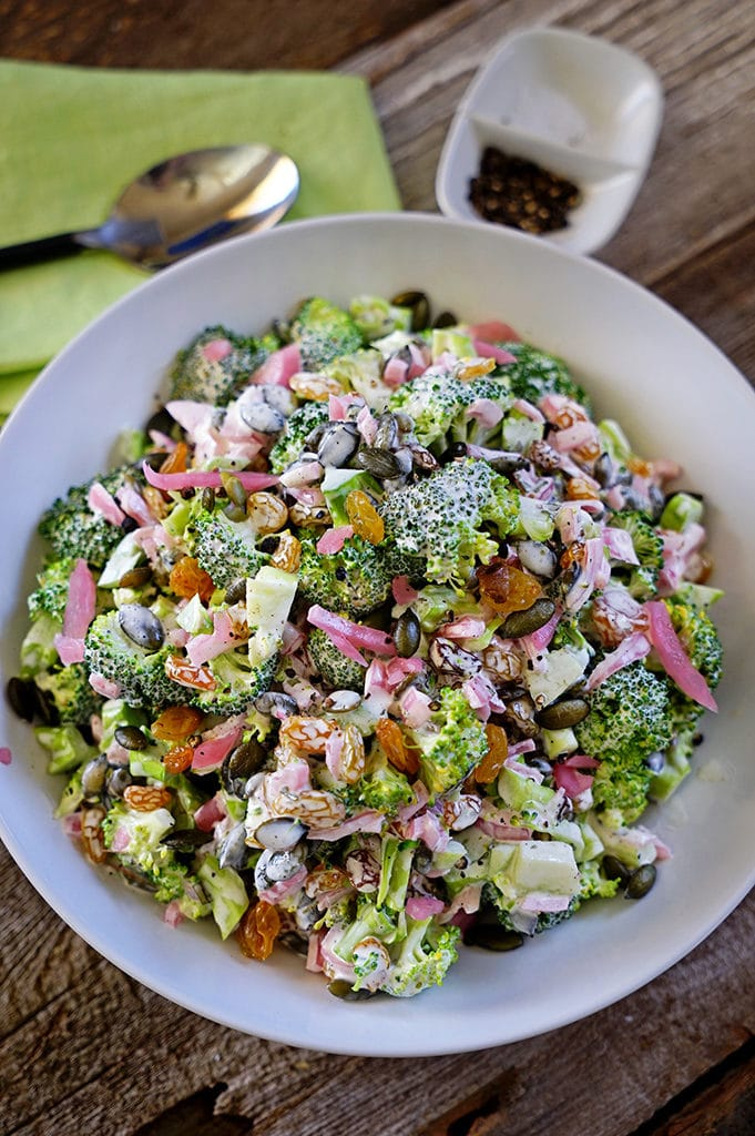 Broccoli Tarragon Salad with Golden Raisins, Marinated Red Onion and Pepitas. www.keviniscooking.com