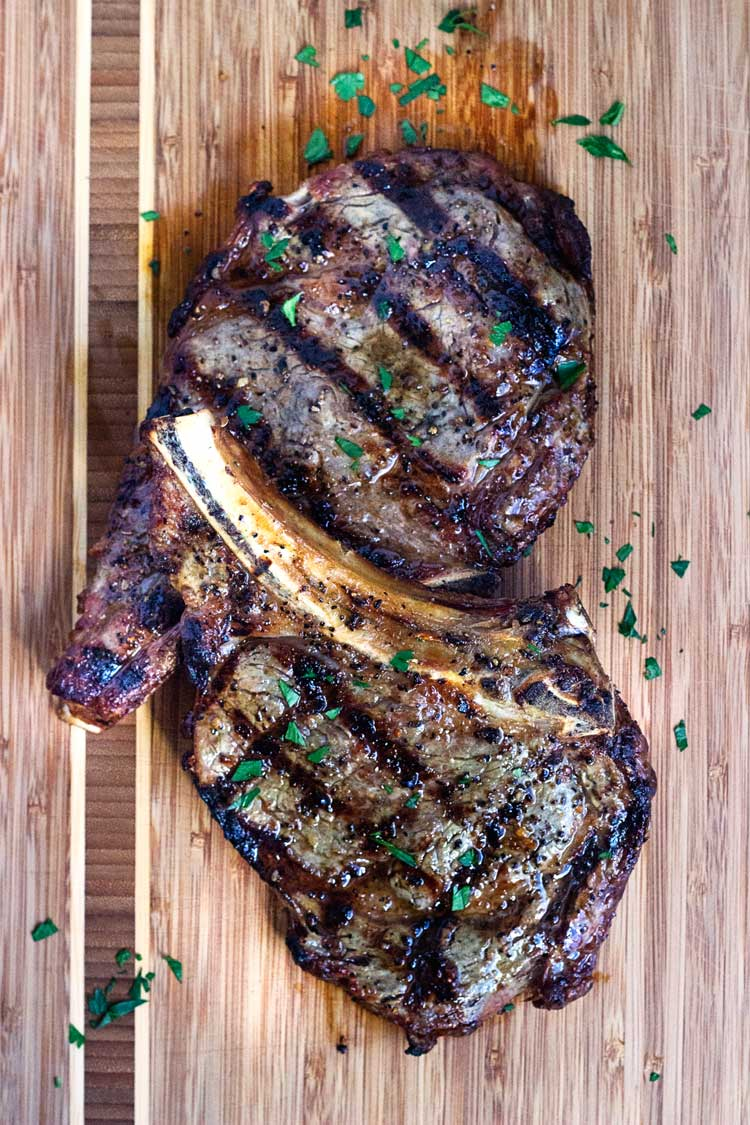 This Perfect Rib Eye Steak has a seasoning that includes dill seed and orange zest and after grilling is topped with compound butter. Steak lover heaven! www.keviniscooking.com