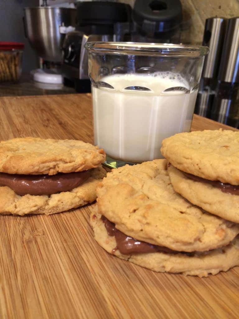 peanut butter sandwich cookie and milk