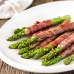 Savory, salty, and crispy, these Asparagus Wrapped in Prosciutto and Sage are such a perfect side dish that can also double as an appetizer.www.keviniscooking.com