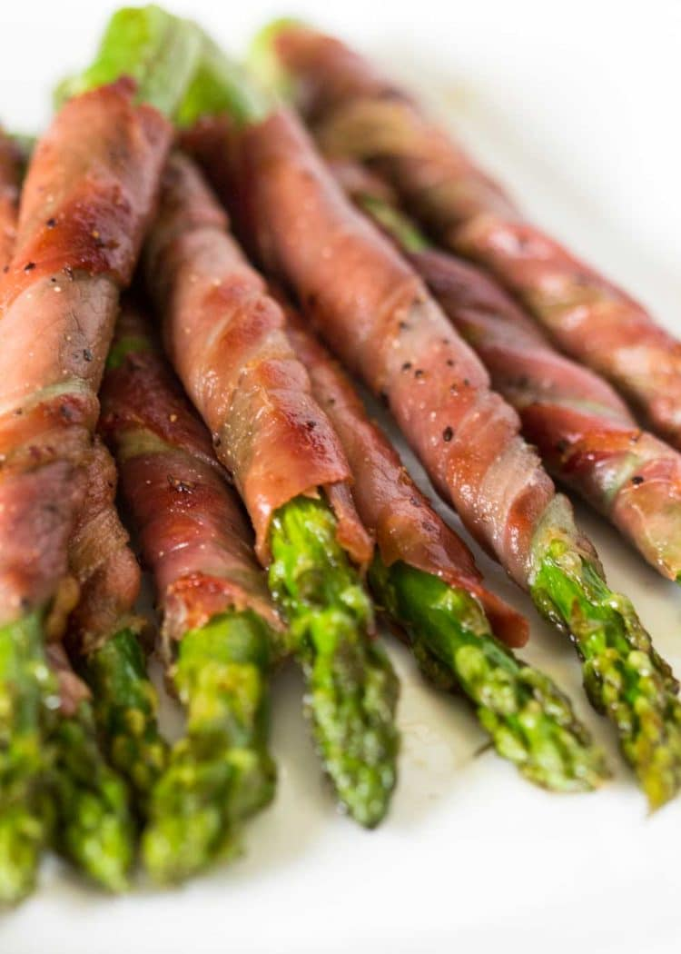 Savory, salty, and crispy, these Asparagus Wrapped in Prosciutto and Sage are such a perfect side dish that can also double as an appetizer. www.keviniscooking.com