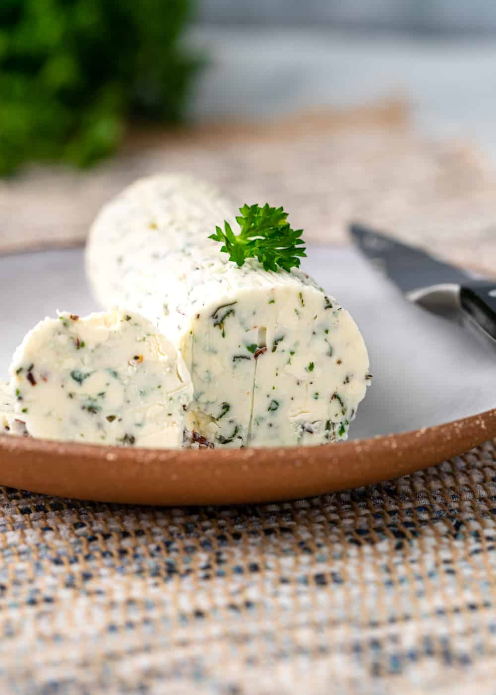 small plate of Gorgonzola butter: compound butter with fresh herbs and blue cheese