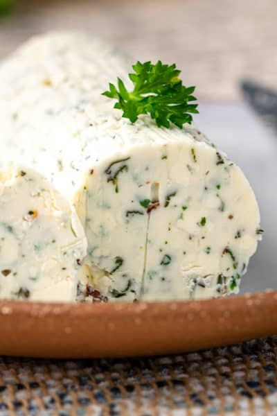small plate of steak butter (compound butter for steak) with fresh herbs and Gorgonzola blue cheese