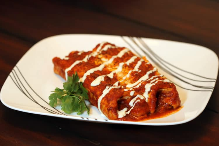 Pork and Cheese Enchiladas in Red Sauce serving