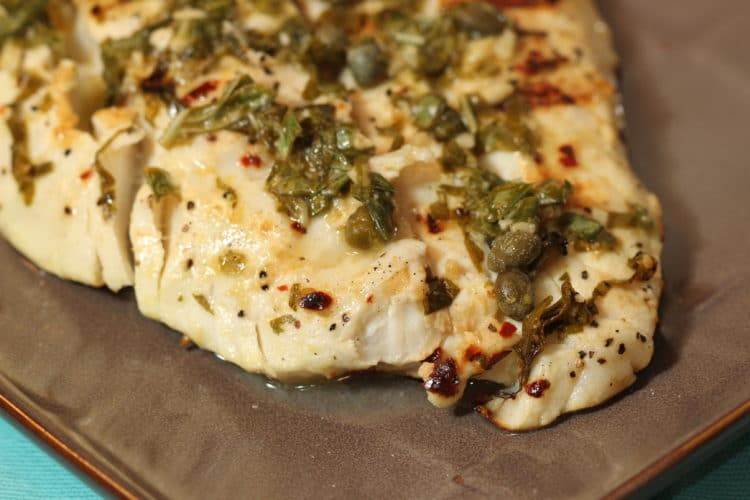 grilled halibut with lemon capers basil closeup