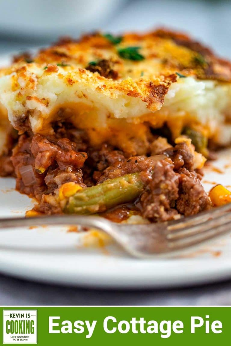 Easy Cottage Pie has ground beef simmered with onions, garlic, thyme in a savory red wine and tomato that's topped with vegetables and then mashed potatoes. #StPatricksDay #cottagepie #groundbeef