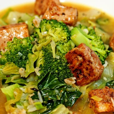 A plate of food with blackened ahi broccoli Soup