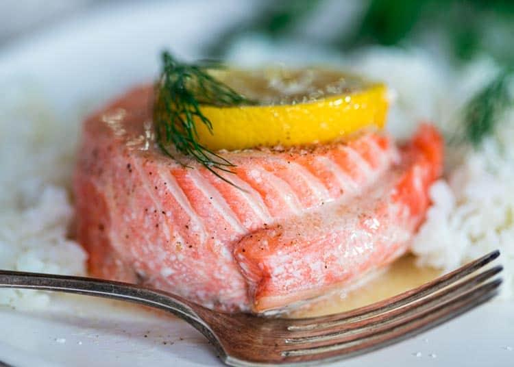cooked salmon pinwheel with lemon slice