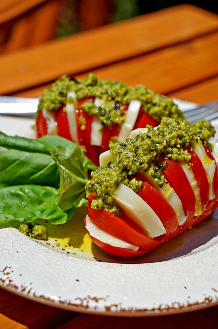 Hasselback Caprese Salad with Fresh Pesto - keviniscooking.com