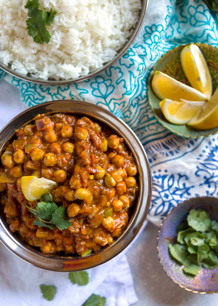 overhead photo of Easy Chickpea Masala with rice and lemon