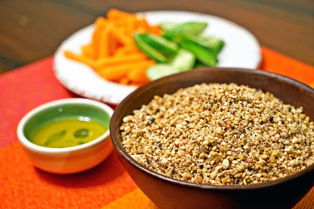 This Egyptian Dukkah spice mix is a warm and spicy concoction to be used for dipping. Primarily made of toasted, ground nuts spices and seeds.