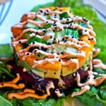 Fresh Ahi Poke Stack with Papaya Avocado and Sriracha Whipped Cream Drizzle