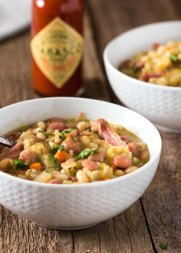 There's nothing like a Slow Cooker Ham Bone Bean Soup simmering away. Smoked ham bone with beans and barley, vegetables and Tabasco for that special touch. This really feeds a crowd! www.keviniscooking.com