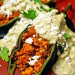 A close up of Poblano stuffed chiles and Cream