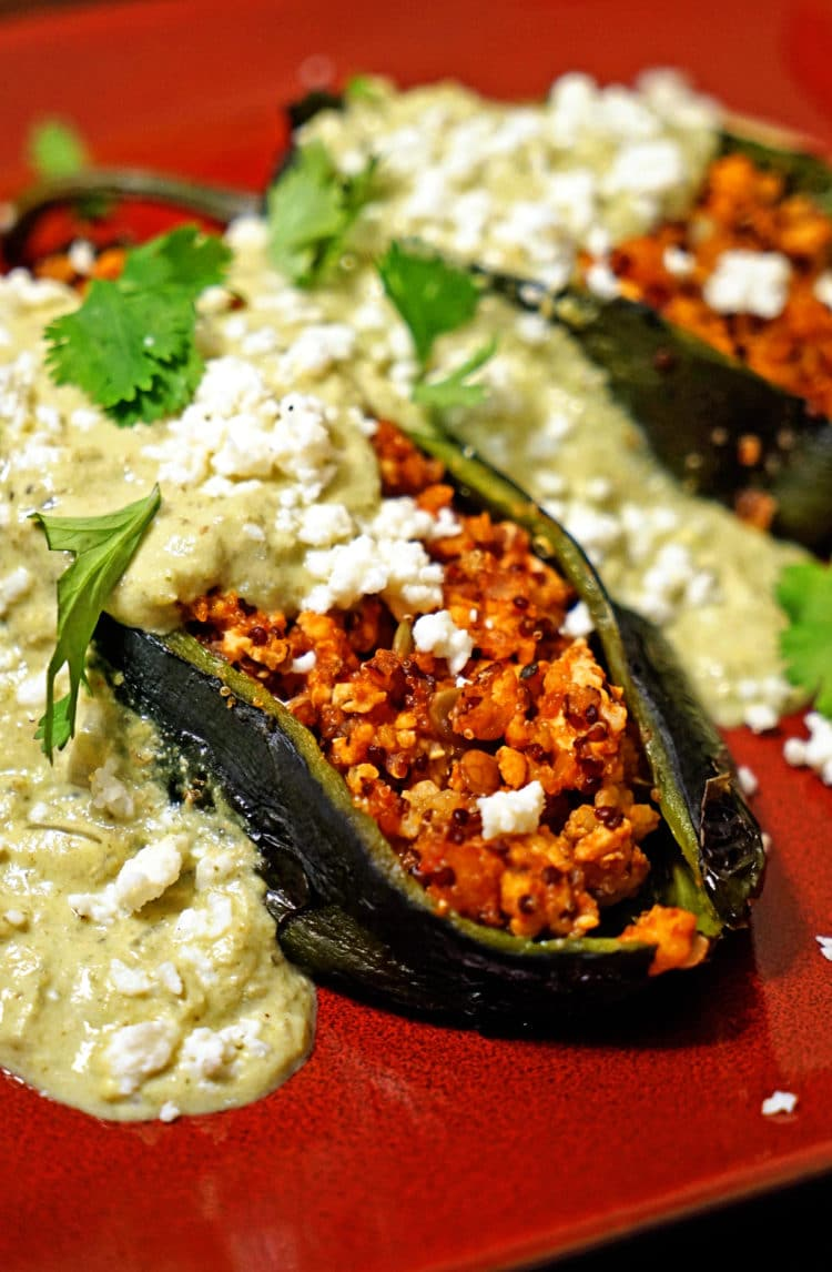 Pour the green chile cream sauce on top of each stuffed poblano pepper ...