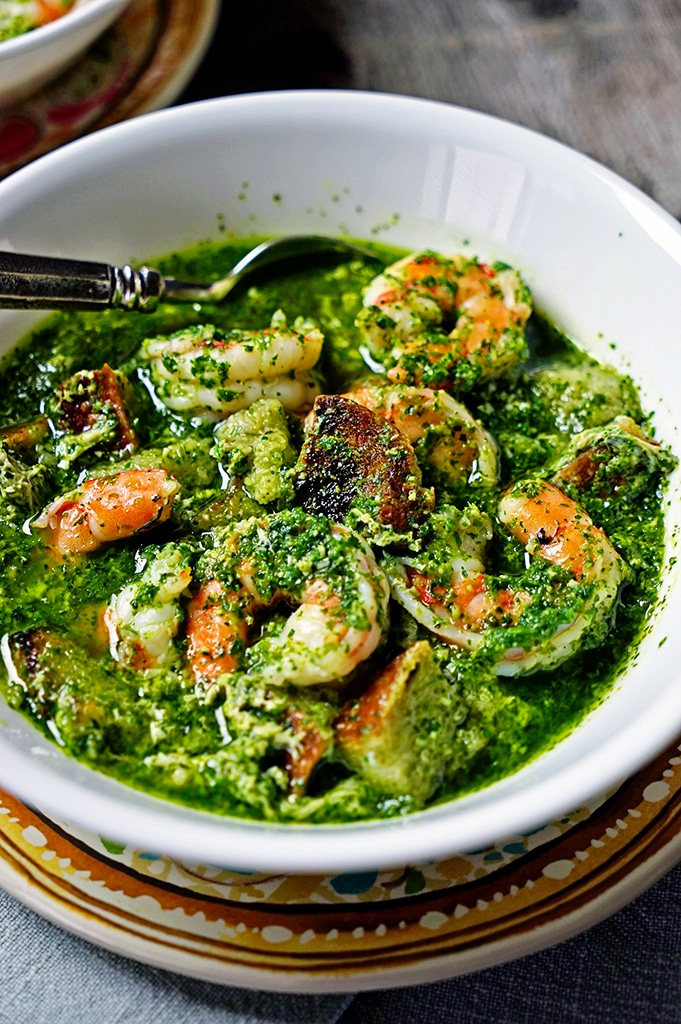 Portuguese Bread and Garlic Soup with Cilantro and Shrimp is beyond flavorful. This satisfying, rustic soup starts with a garlic, cilantro and serrano chile paste and when the shrimp is added makes for a filling, aromatic soup. www.keviniscooking.com