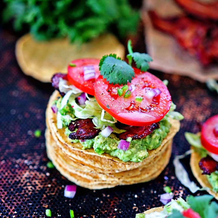 BLT Tostadas with Guacamole - A Mexican twist on an American classic sandwich - bacon, lettuce, tomatoes and a spicy guacamole all atop a crunchy tostada.  keviniscooking.com