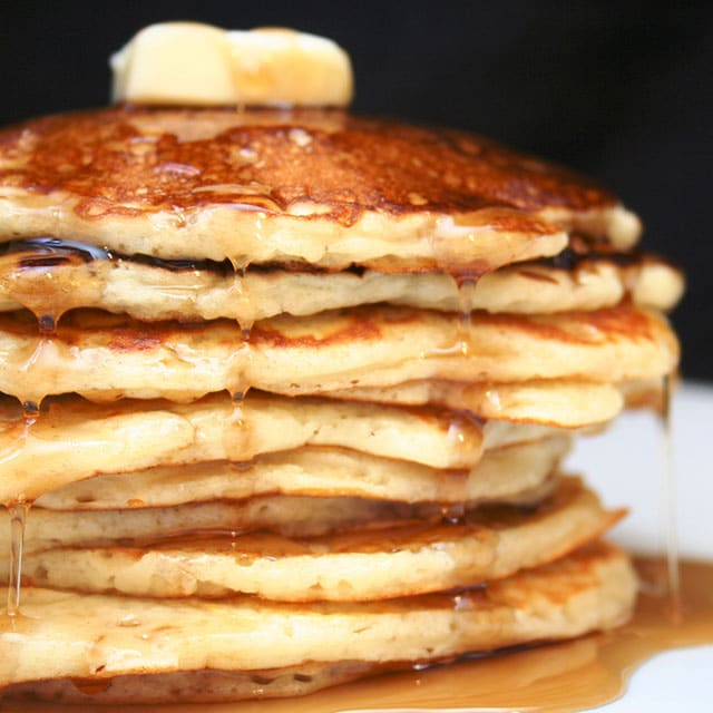 stack of Sourdough Pancakes with butter and dripping maple syrup