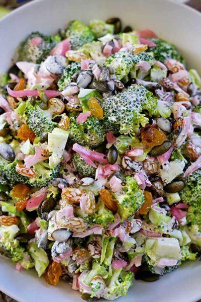 Broccoli Tarragon Salad with Golden Raisins, Marinated Red Onion and Pepitas