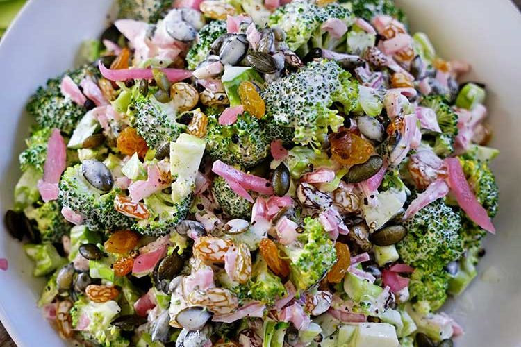 Broccoli Tarragon Salad with Golden Raisins, Marinated Red Onion and Pepitas