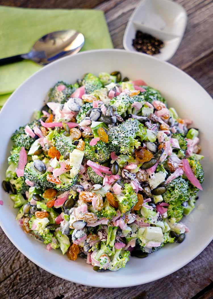 Tarragon Broccoli Salad with Golden Raisins, Marinated Red Onion and Pepitas - this fresh, crunchy and healthy salad is the perfect side dish or main!. Packed with texture and flavors, so good! keviniscooking.com