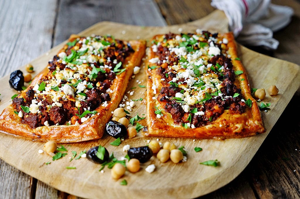 This Greek Lamb, Chickpea and Feta Tart is made with warm spices, ground lamb, olives, feta cheese and puff pastry. Delivers big on flavor! www.keviniscooking.com