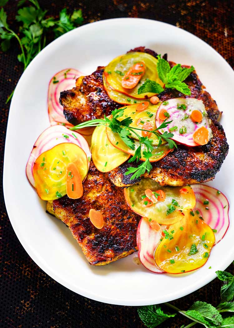 Honey Turmeric Pork Cutlet with Rainbow Beet and Carrot Salad. Pounded pork cutlets get a marinade of garlic infused yogurt, honey, lemon juice and turmeric and topped with a bright, thinly sliced beet salad. keviniscooking.com