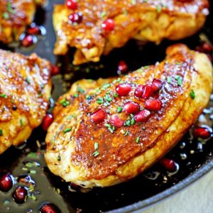 Jordanian Roasted Chicken with Pomegranate Molasses gets a rub of cardamom and sumac under the skin prior to searing then roasted with pomegranate molasses. www.keviniscooking.com