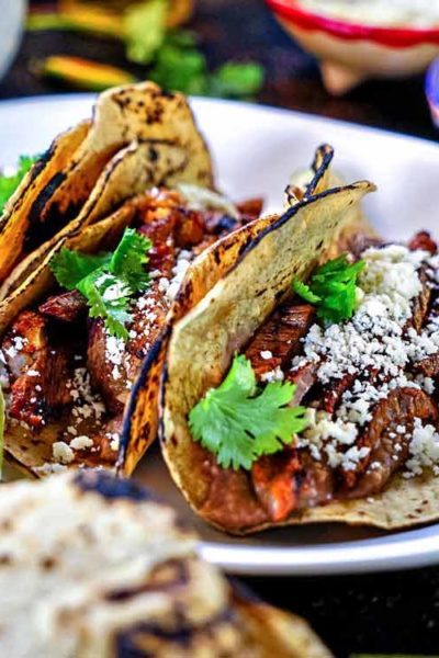 A plate of Mojo Tacos with cotija cheese