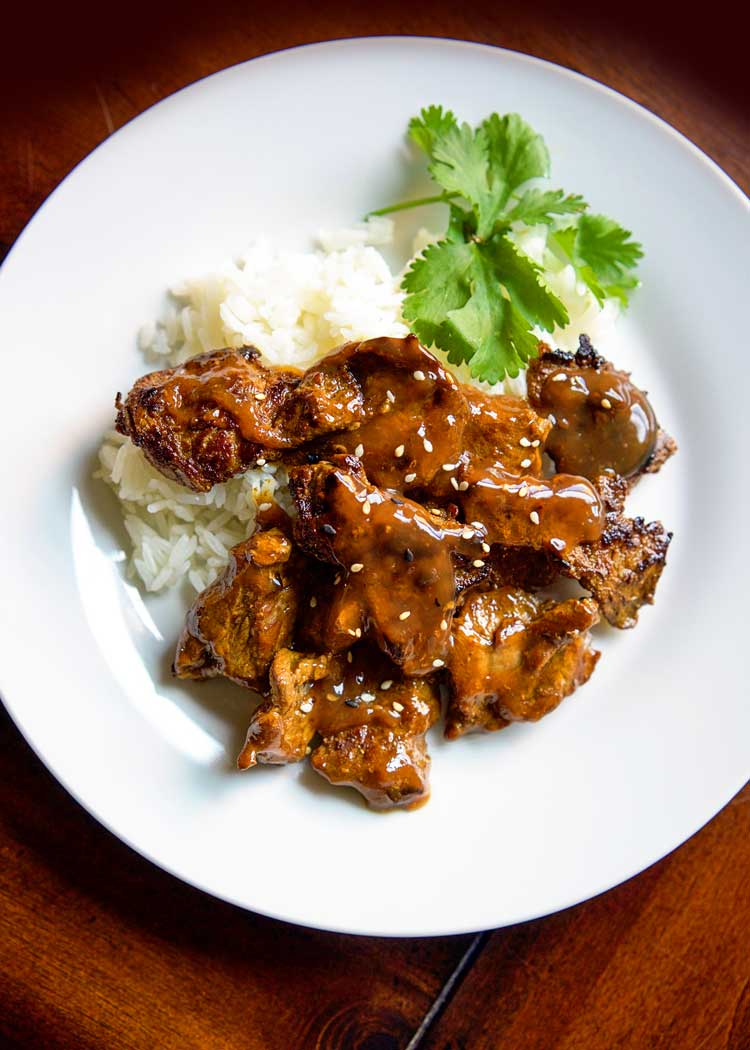 This Crispy Curry Beef Stir Fry has marinated flank steak in rice vinegar, curry powder and soy sauce then sears for crispy edges in an easy aromatic sauce. keviniscooking.com