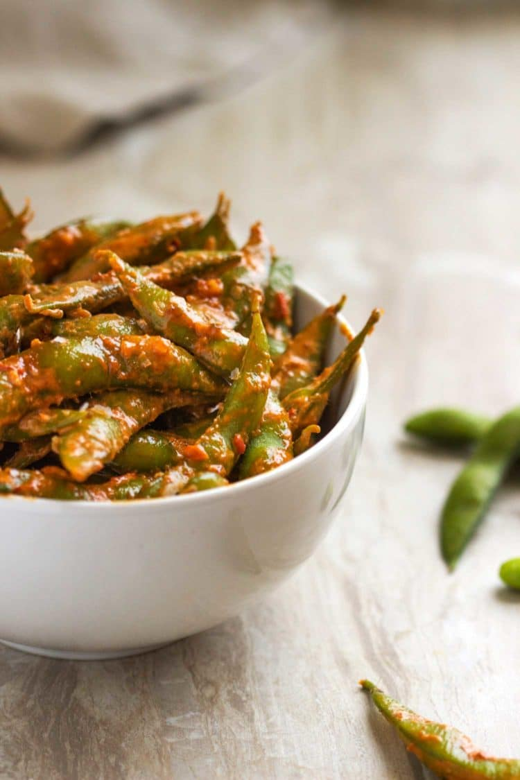 These Garlic Chili Edamame are an easy to prepare snack that can be on the table in 10 minutes from start to finish. keviniscooking.com