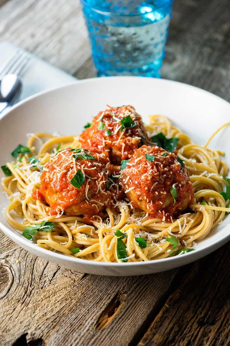 These Roman Meatballs have pine nuts, golden raisins, red pepper flakes, herbs and cheeses, then are simmered in a zesty and spicy Arrabbiata Sauce. So good! www.keviniscooking.com