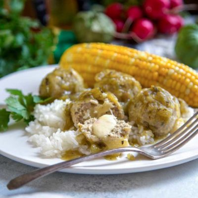 These baked, pepper jack cheese Stuffed Green Chili Meatballs are made with ground turkey, ground oats instead of breadcrumbs and a tomatillo sauce.