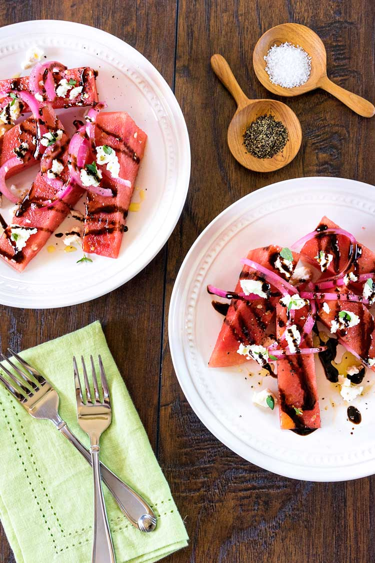 This Watermelon Salad has arugula, pickled red onions, creamy goat cheese, balsamic syrup and roasted pumpkin seeds. It's a perfect starter or side salad. www.keviniscooking.com