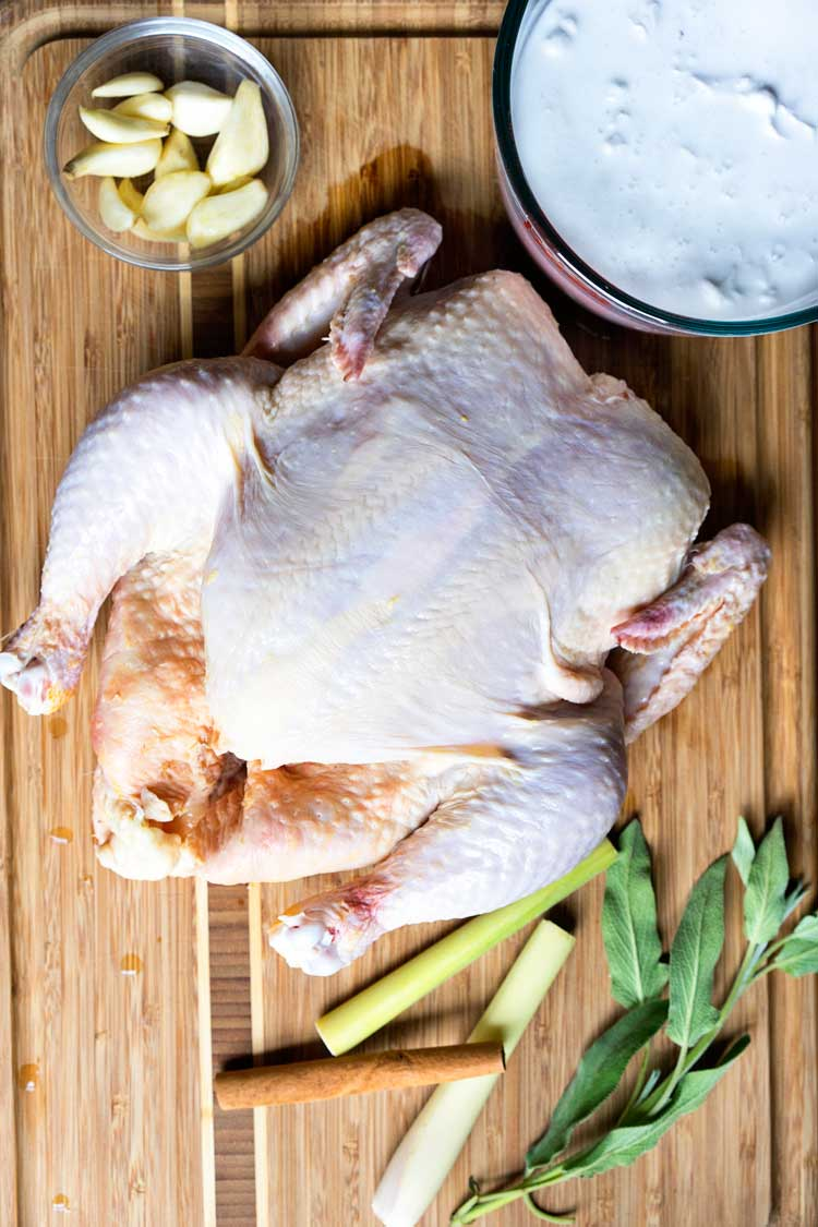 This Thai Roasted Chicken in Coconut Milk uses a whole chicken simmered in coconut milk, cinnamon, lemon grass and sage. Super easy and very aromatic, it tastes as good as it smells. keviniscooking.com