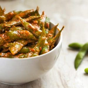 Amazing garlic and chili paste sauce coats fresh steamed edamame. An addicting, lip smacking snack I always get asked the recipe for!