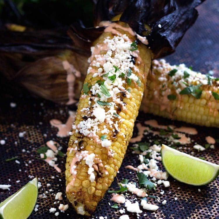 Grilled Corn with Cotija and Sriracha Crema. www.keviniscooking.com | My family and friends go crazy when we serve these up for grilling BBQ parties. Hand held, spicy, and covered with cheese crumbles, this corn is the best!