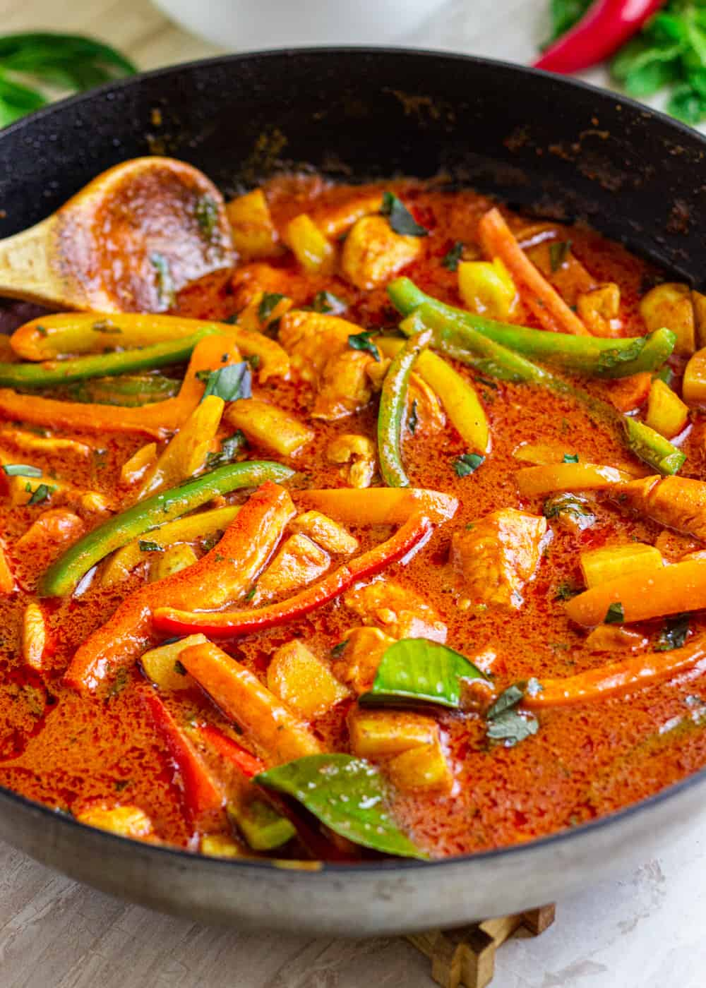 A pan filled with meat and vegetables, with Red curry