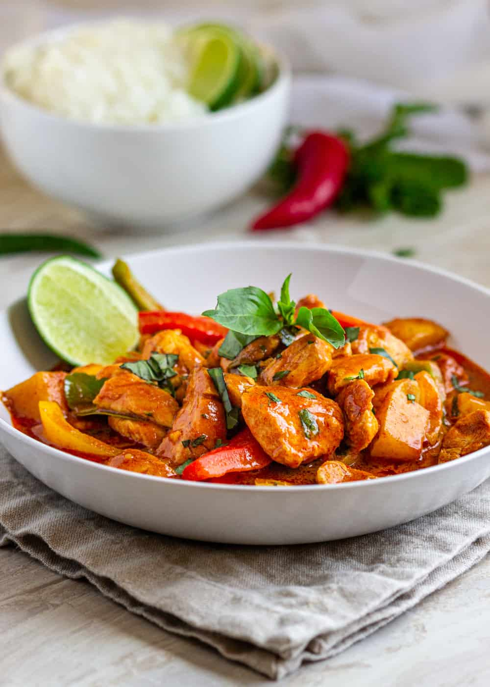 bowl of Thai Red Curry with Chicken with basil garnish