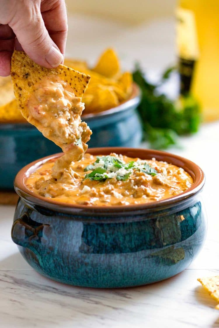 This is a super easy and beefed up Beef Queso Dip perfect for any party, on top of french fries, baked potatoes or steamed vegetables. www.keviniscooking.com