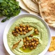 This Cilantro Jalapeno Hummus is an easy, healthy dip made in minutes with fresh ingredients. Great as a spread, too! www.keviniscooking.com