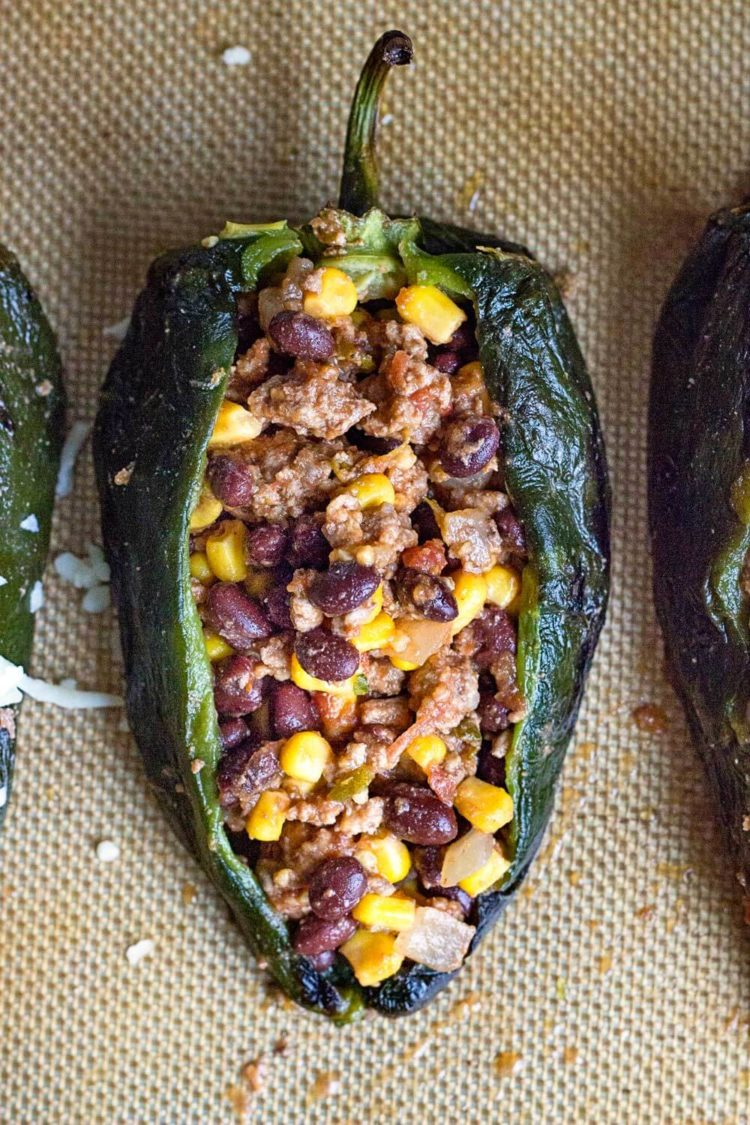 These Tex Mex Stuffed Peppers are filled with ground beef, black beans, corn, and pepper jack cheese! So good, great for large crowds, too. www.keviniscooking.com