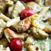Tender browned chicken, smothered in a creamy pesto sauce with pasta and tomatoes. A delicious Italian inspired meal that can feed a crowd. Easily double it for more than 4, the family loves it! www.keviniscooking.com