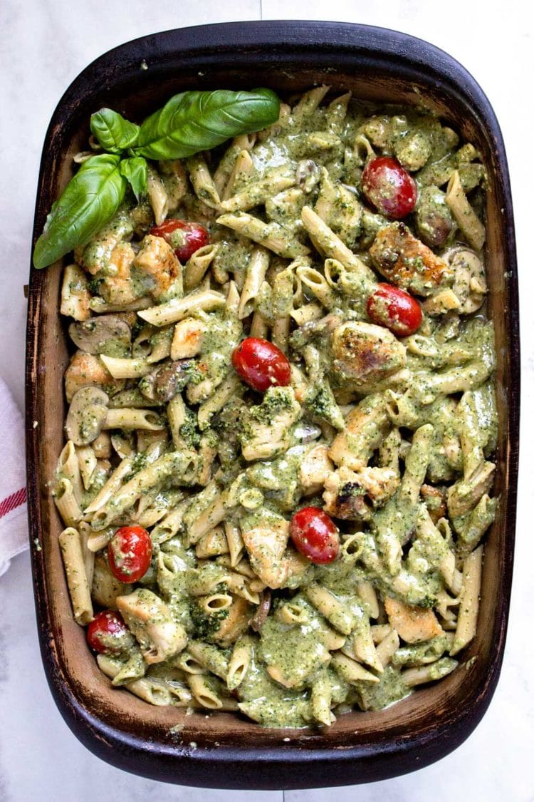 Tender browned chicken, smothered in a creamy pesto sauce with pasta and tomatoes. A delicious Italian inspired meal that can feed a crowd. Easily double it for more than 6, the family loves this Pesto Chicken Pasta! www.keviniscooking.com