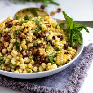 A plate of food with corn Hazelnut and Salad